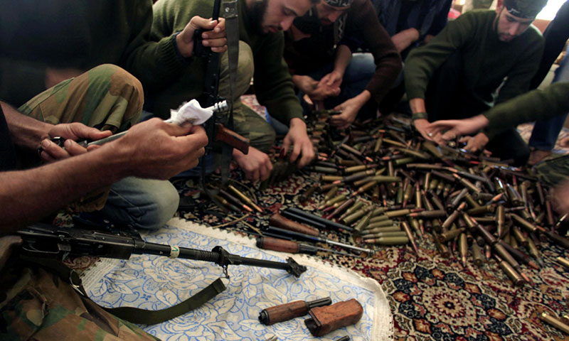 Members of the Free Syrian Army cleaning their weapons in the city of Aleppo - November (AP)