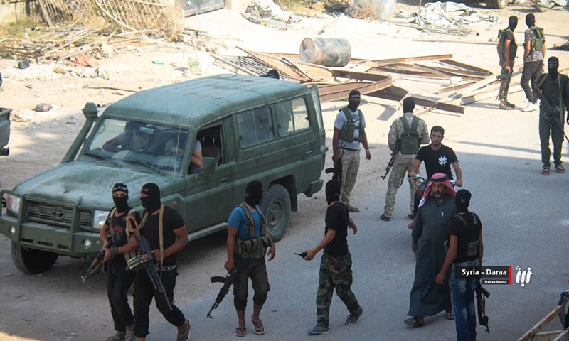 Elements of the opposition factions during a security operation in the city of Daraa, south of Syria - (Nabaa News Agency)