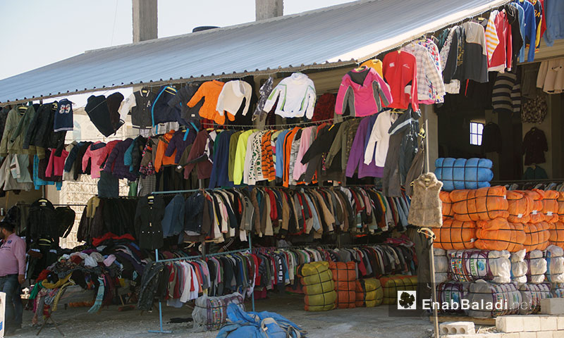 A shop for second hand clothes in the city of Idlib - January 2018 (Enab Baladi)
