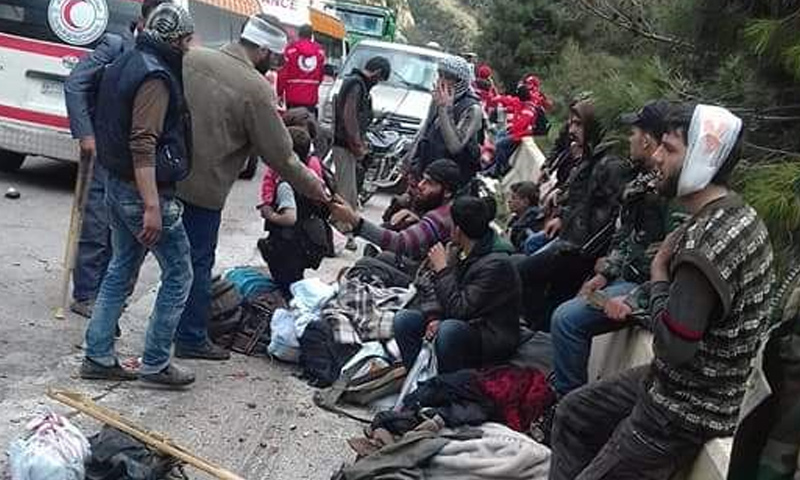 Injured people in the crash of the buses carrying eastern Ghouta's displaced people– March 31. 2018 (Facebook)