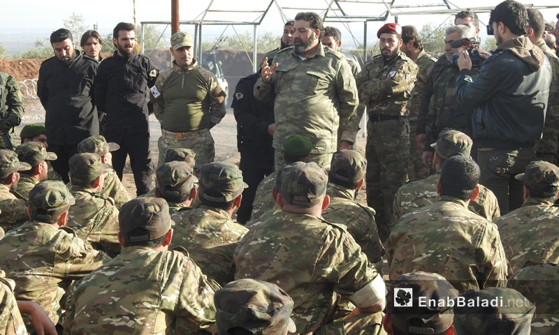 Al-Mu'tasim Brigade, under the Syrian Free Army, during the graduation of another group of fighters - 27 December, 2017 (Enab Baladi)