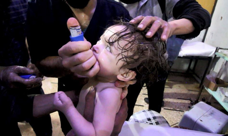 A first responder trying to save one of Assad's chemical attack's victims – April 7. 2018 (Duma Coordination)