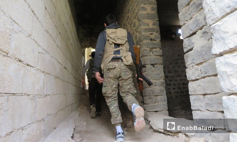 An opposition fighter in the Rastan fronts in northern Homs – March 2018 (Enab Baladi)