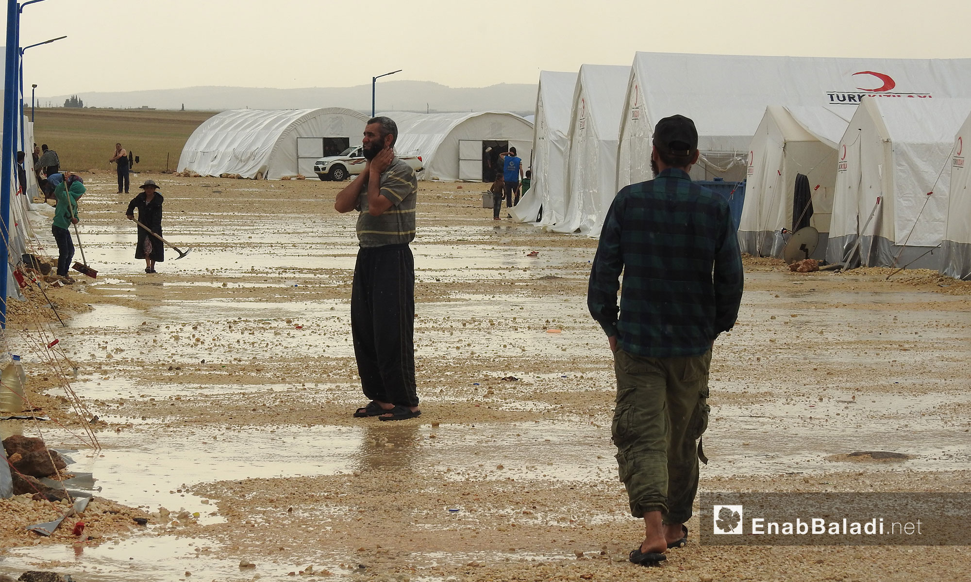 People displaced from Eastern Ghouta after the rainfall in the al-Bal camp in the northern countryside of Aleppo – May 22, 2018 (Enab Baladi)
