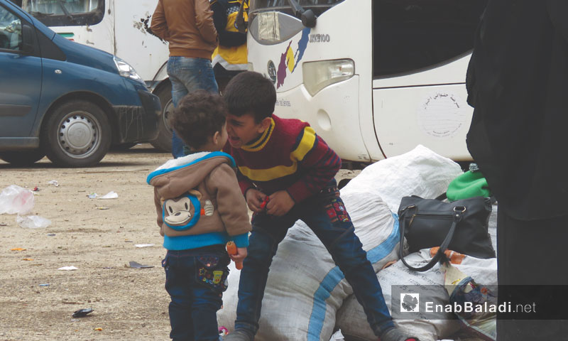 Two children playing after they arrived from Arbin to Qalaat al-Madiq west of Hama - March 25, 2018 (Enab Baladi)