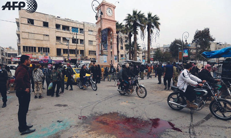 Blood stains near the Clock Tower in the Syrian city of Idlib after an explosion of an explosive device - February 2018 (Omar Haj Kadour - AFP)
