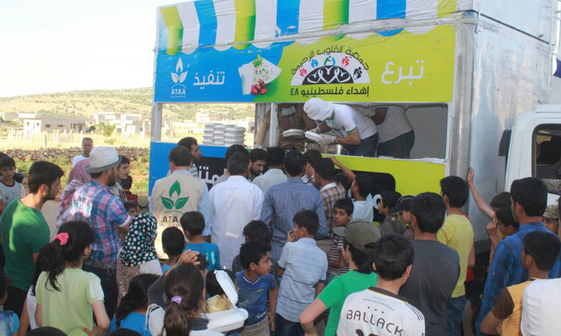 """""""Ataa"""" Association for Humanitarian Relief utilizes nontraditional means, a mobile kitchen, to reach fasting people in remote areas in northern Syria."""