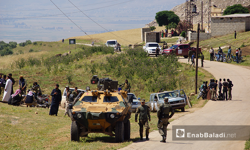 """Turkish armored vehicles on the way to fix the 12th """"de-escalation"""" monitoring point in Idlib – May 16, 2018 (Enab Baladi)"""