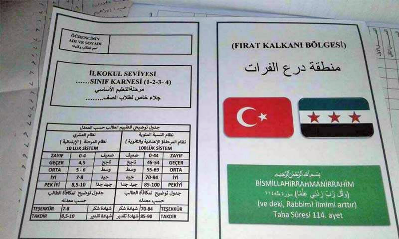 Flag of the Syrian revolution and Turkey on the covers of school reports in northern Aleppo - January 15, 2018 (activists)