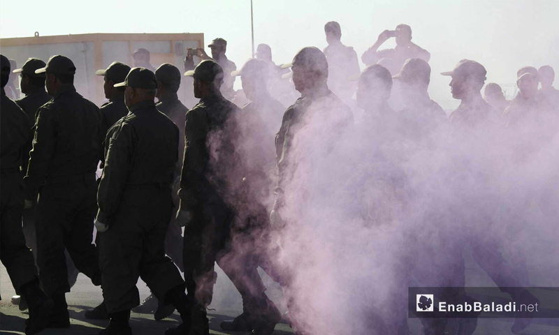 """Parade by the """"National"""" Police in celebration of the first graduate class – December 15, 2017 (Enab Baladi)"""