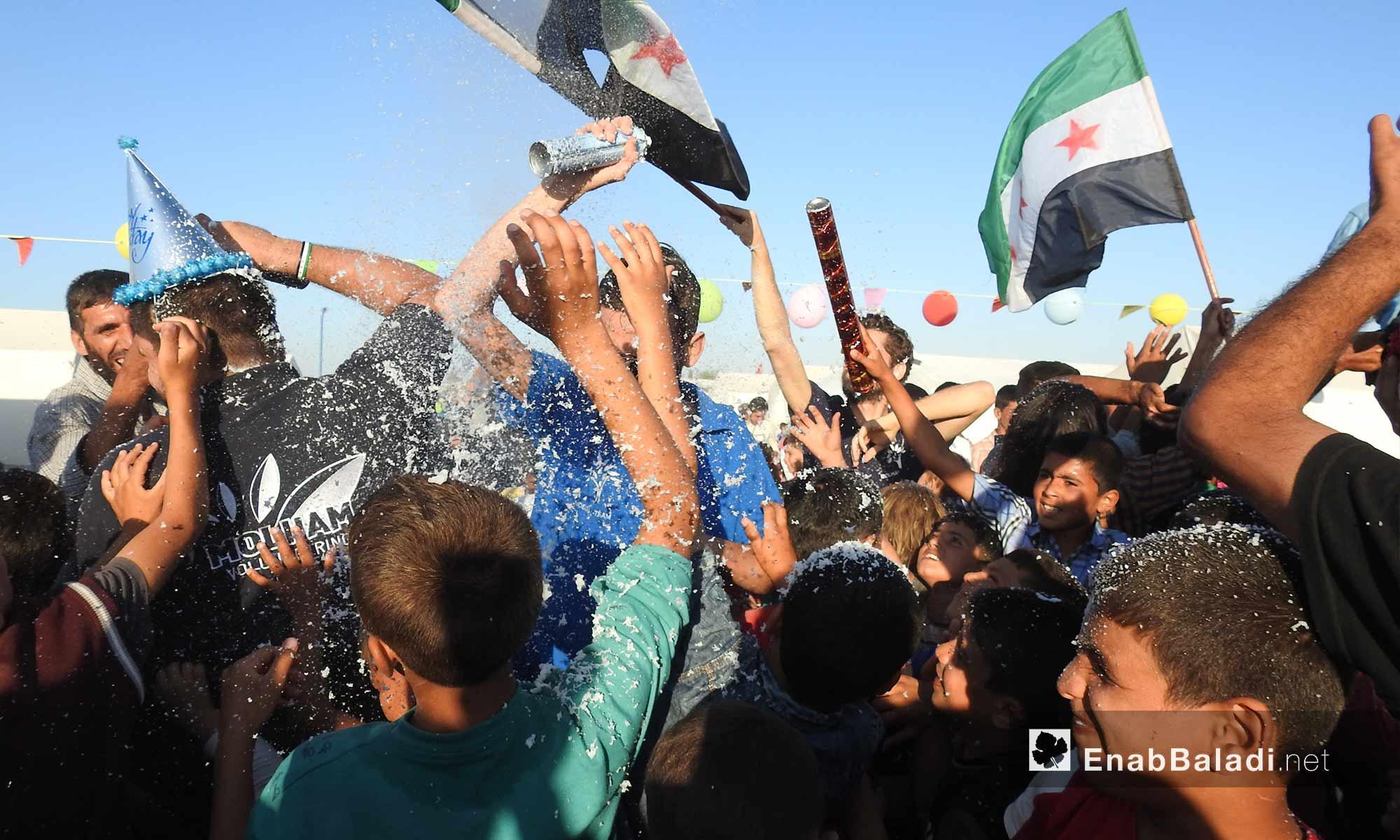 Children celebrating Eid al-Fitr in Bel town's school in the northern countryside of Aleppo – June 17, 2018 (Enab Baladi)