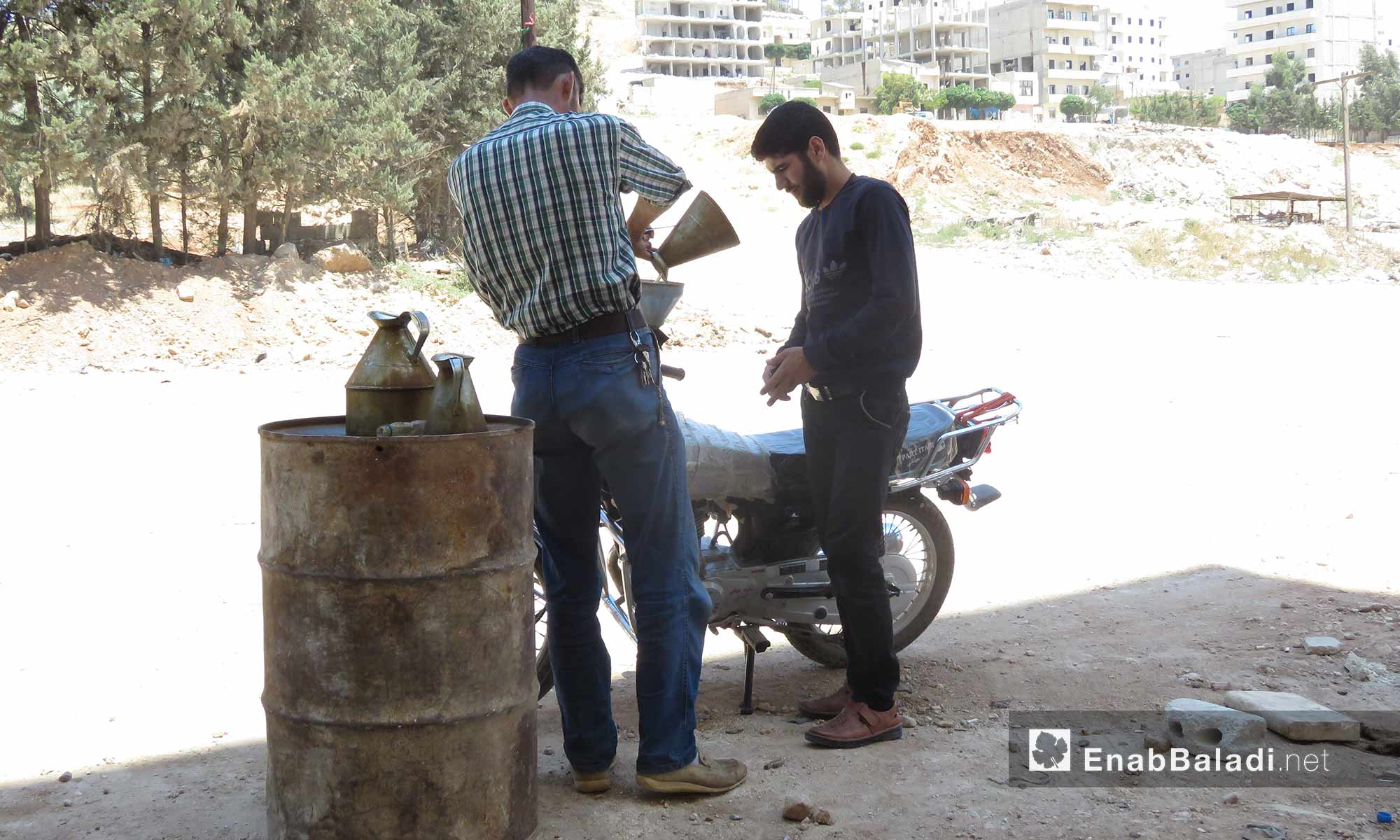 A fuel merchant in the city of Afrin, rural Aleppo – June 21, 2018 (Enab Baladi)