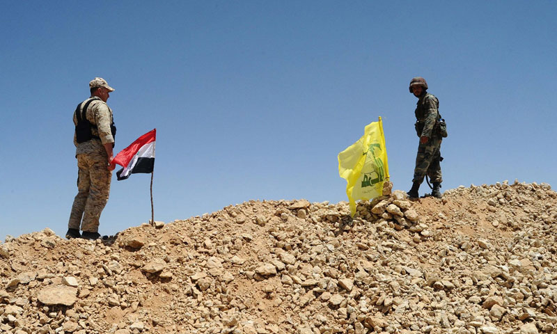"""A Syrian solider and a member of """"Hezbollah"""" Lebanese party (Lefigaro)"""