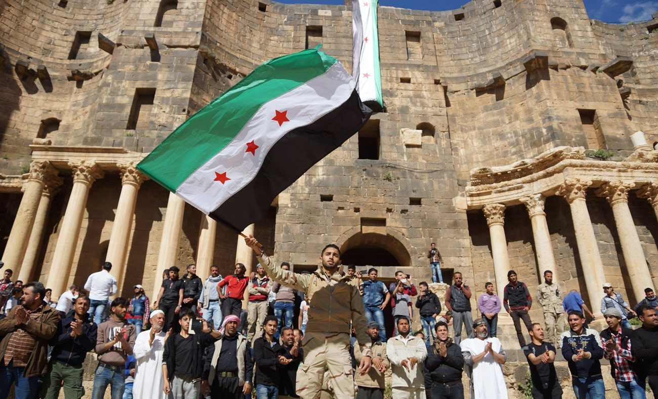 Demonstrators in Busra al-Sham, rural Daraa, commemorating the Syrian revolution – March, 2016 (Reuters)