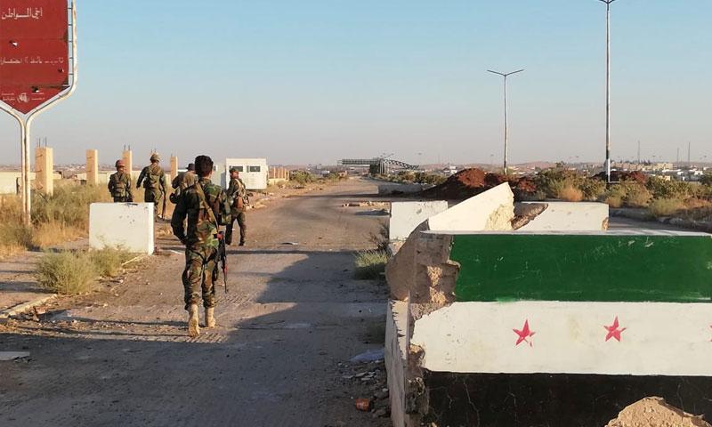Assad's forces troops at al-Nassib border crossing after controlling it – July 6, 2018 (Reuters)