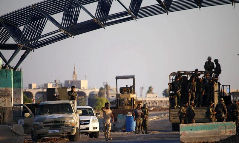 Caption: Assad's force at the Nassib Border Crossing (AFP)