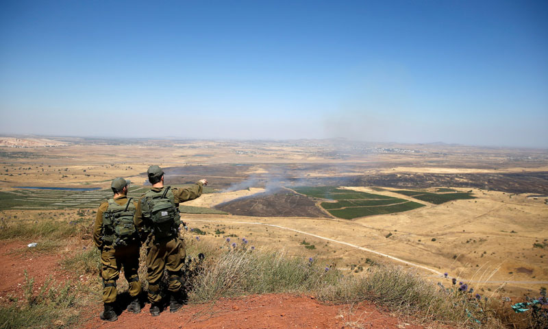 Israeli troops looking at the Syrian side of Golan Heights – July 7, 2018 (Reuters)