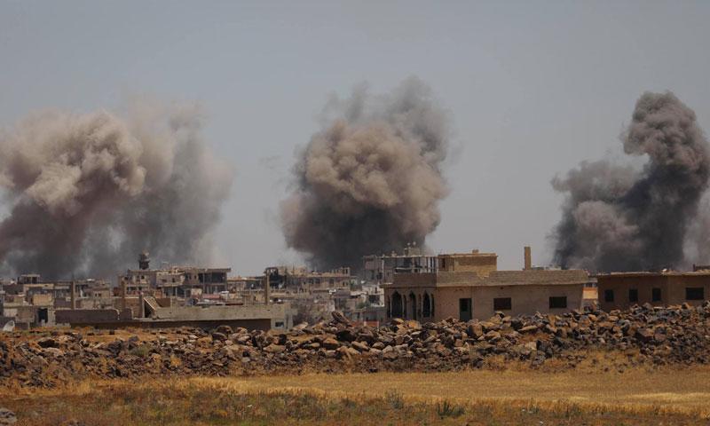 Pillars of smoke resulting from the bombardment on the town of al-Hirak in rural Daraa, Jun 25, 2018 (Photographer Ala al-Faqir)