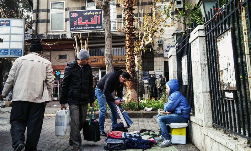 A child selling clothes on al-Jisr al-Abiad street, Damascus – February 24, 2017 (Lens of a Damascene Young Man)