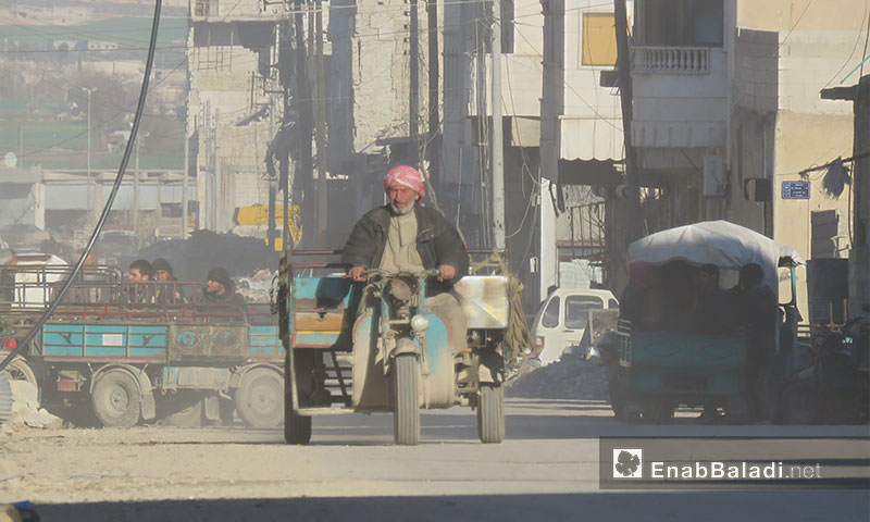 An old man driving a motorcycle in the city of al-Bab following its liberation – March 19, 2017 (Enab Baladi)