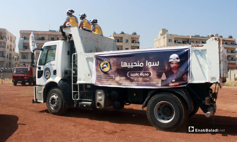 Civil Defense members in a campaign for the rehabilitation of roads in Afrin city – August 1, 2018 (Enab Baladi)