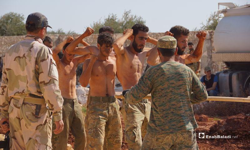 """Jaysh al-Nasr"" (Army of Victory) troops in a training camp, northern rural Hama – July 2018 (Enab Baladi)"