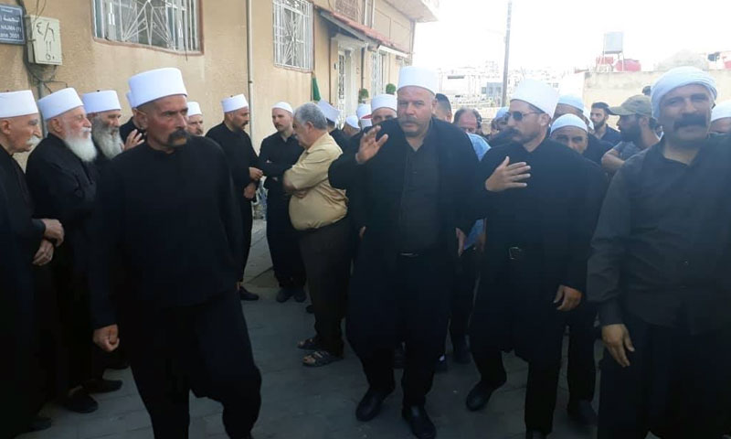 """Personalities from """"Rijal al-Karama"""" at the funeral of one of the people killed in ISIS' attack on Sweida – July 2018 (Rijal al-Karama)"""