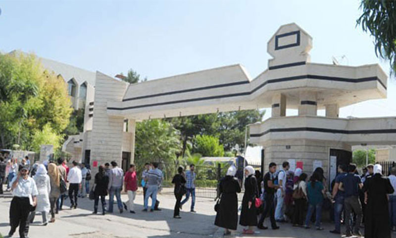 Students at the gate of the College of Arts and Humanities, Damascus University (SANA)