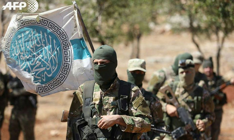 """The graduation of a group of troops under """"Tahrir al-Sham"""" – August 2018 (AFP)"""