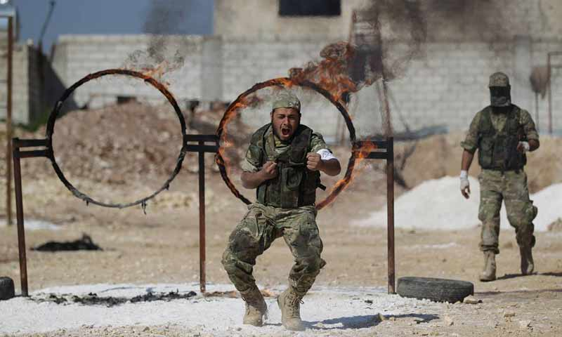 "A troop from ""Jaysh al-Izza"" in a training camp, northern rural Aleppo – August 2018 (Khalil al-Ashawy)"