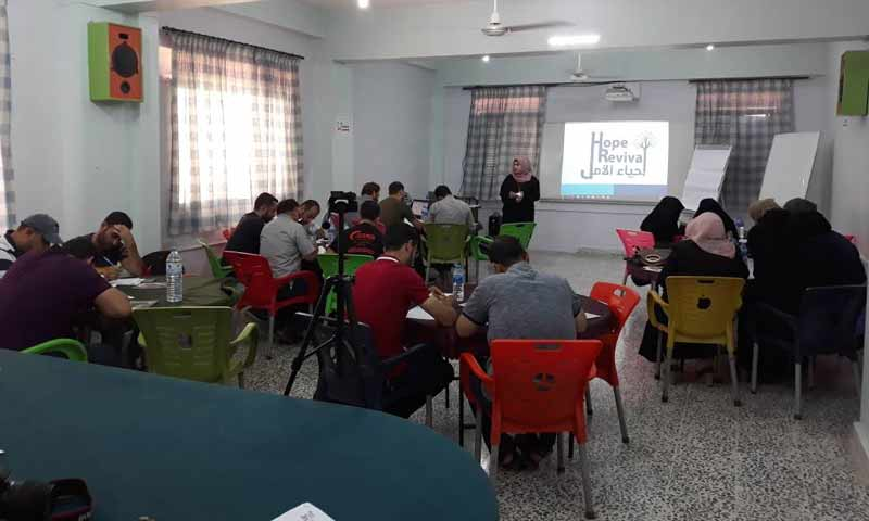 """A session during the event organized by """"Our Life Is Hope"""" organization in Northern Syria – July 2018 (Ihsan Organization)"""