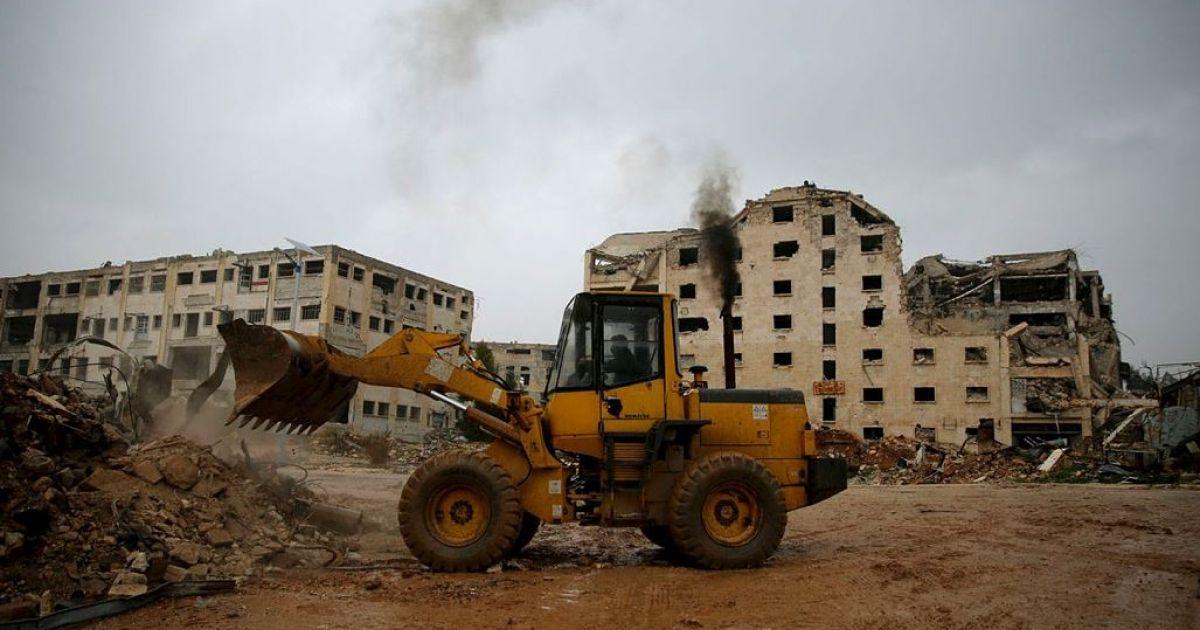 A bulldozer removing the rubble of the war in Bellermun District, Aleppo (AP)