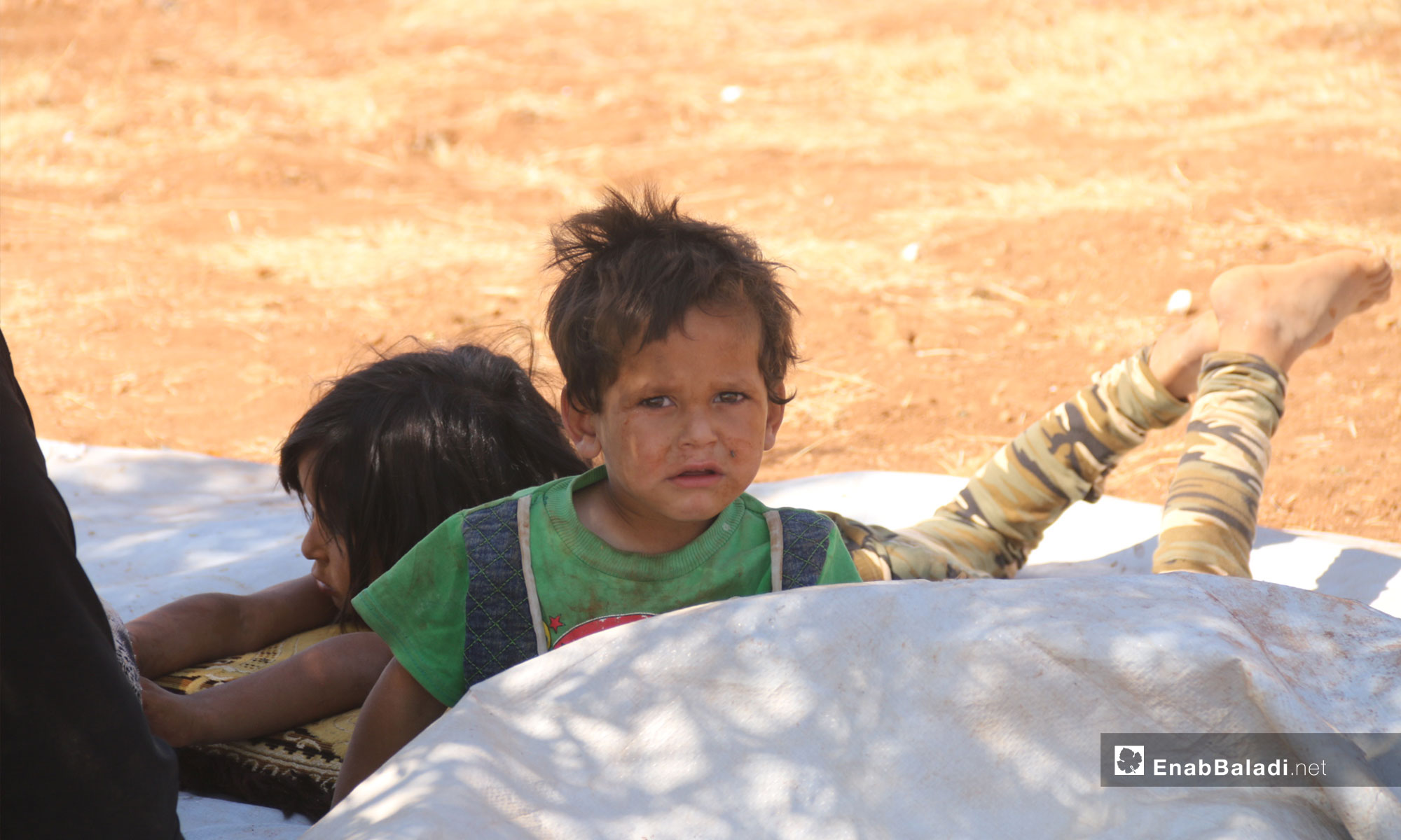 Child displaced from rural Idlib due to shelling to the town of Sarman near the Turkish supervision point in Idlib – September 12, 2018 (Enab Baladi)