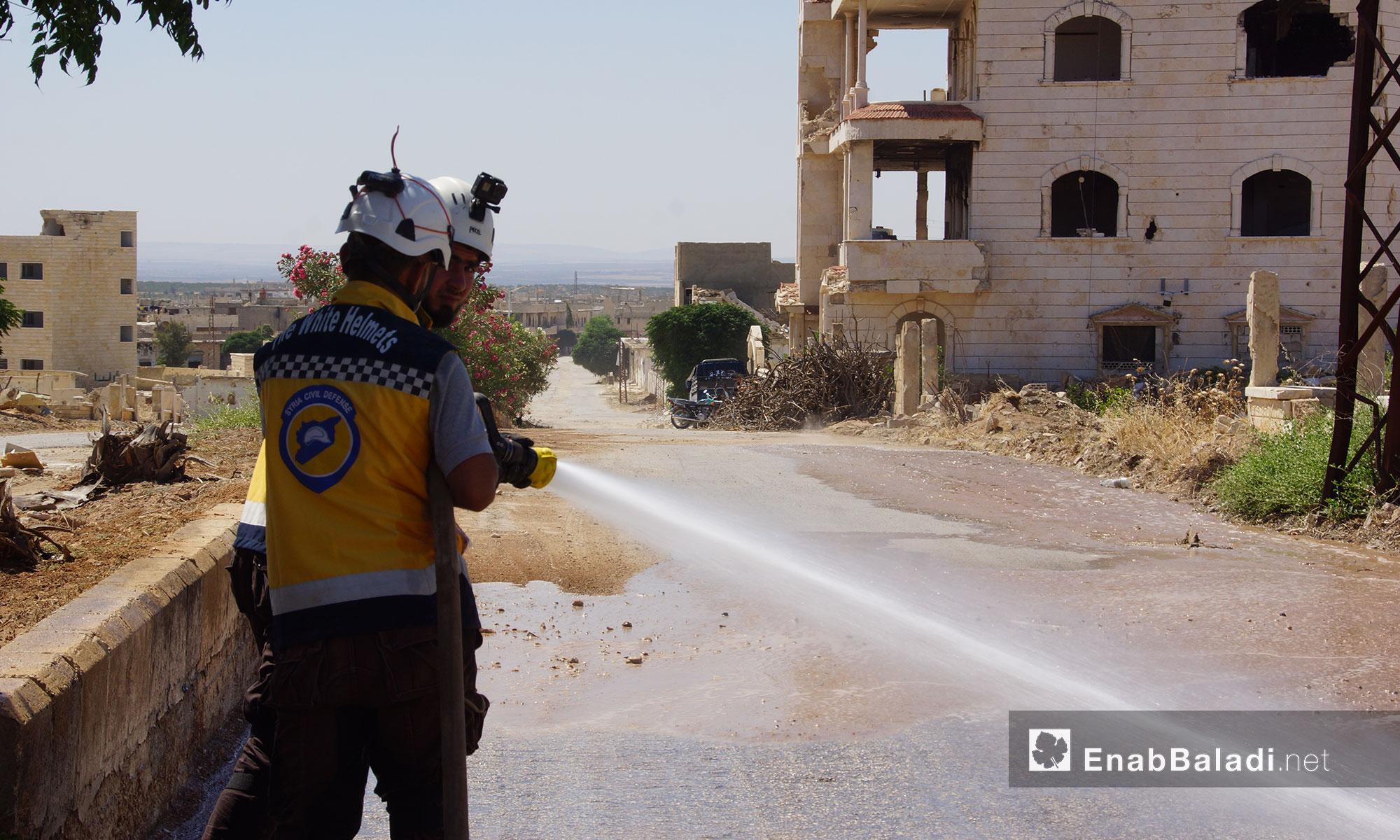 "Civil Defense volunteers cleaning the roads of the city of Murak, rural Hama, under the ""Land Revival"" campaign– July 7, 2018 (Enab Baladi)"