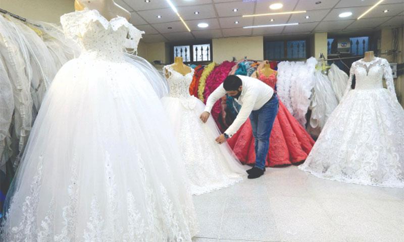 A wedding dresses merchant in Damascus – January 8, 2018 (AFP)