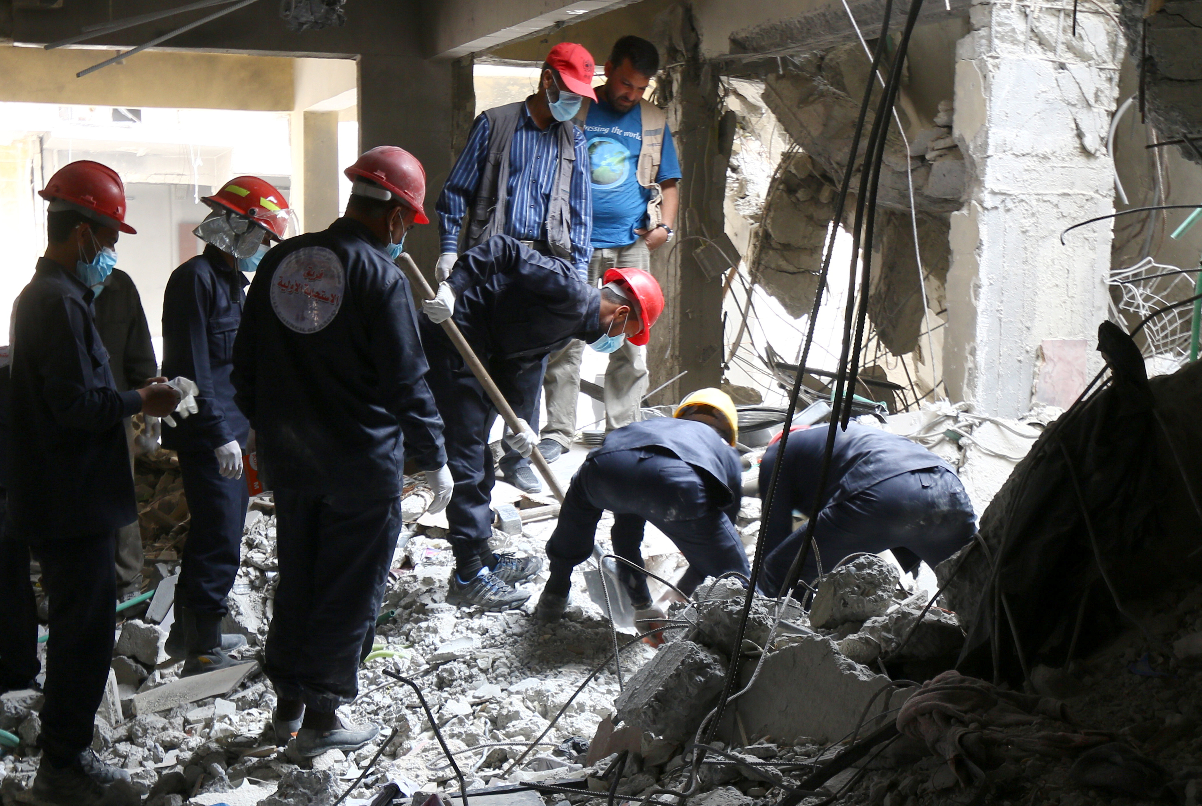 Response Team in Raqqa looking for dead bodies still trapped between rubble - April 9, 2018 (Reuters)