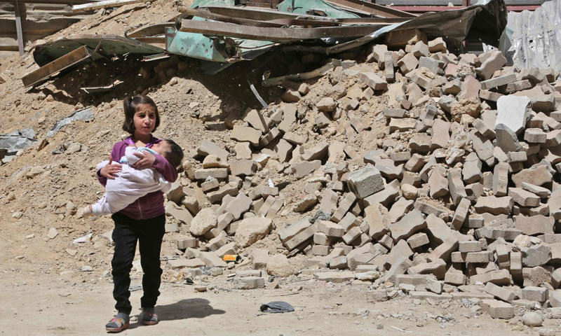 A little girl in the city of Duma, while it was controlled by the opposition, eastern Damascus – April17, 2018 (AFP)