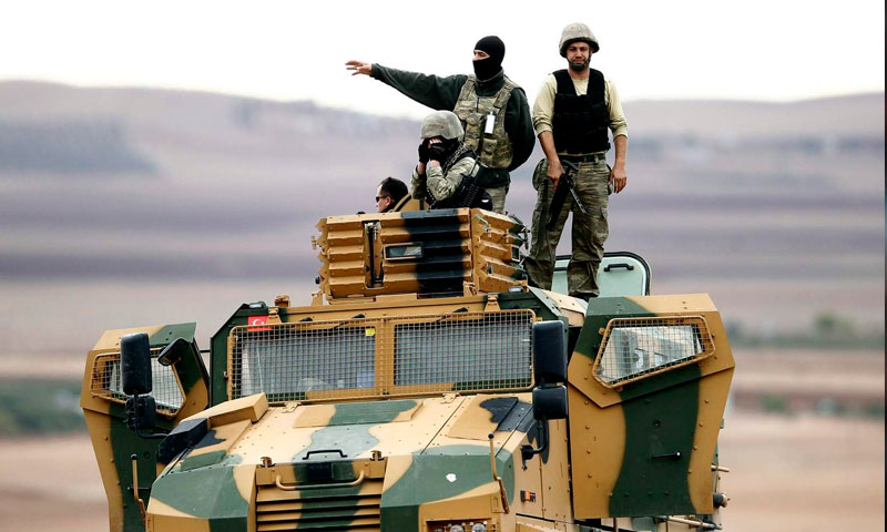 Turkish army troops above a military vehicle at the Syrian Turkish borders (Getty image)