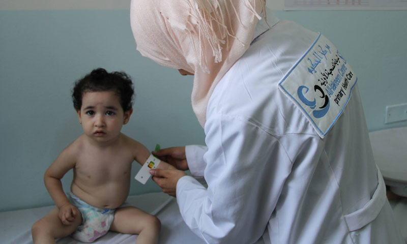 Children medical care clinic at the al-Hakeem center in Idlib – August 2018 (al-Hakeem Center's Facebook Page)