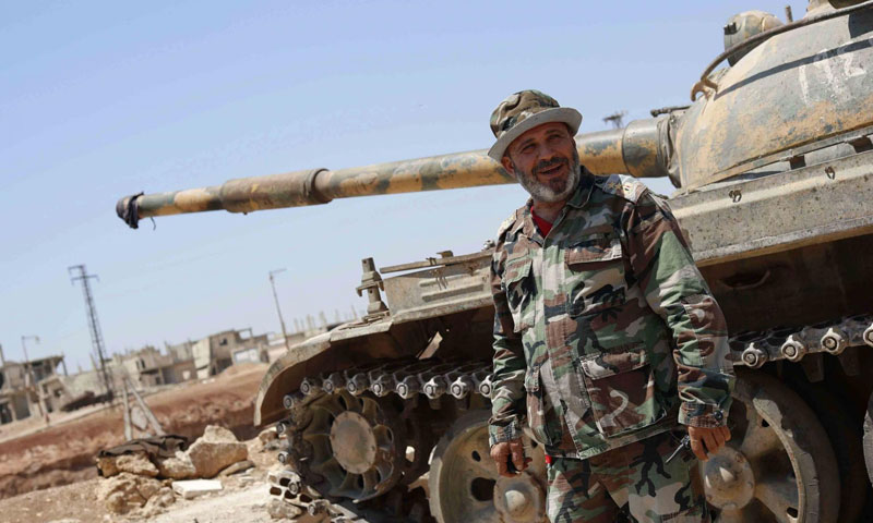 A colonel of Assad's forces on the military fronts in al-Rastan, rural Homs – July 2018 (AP)