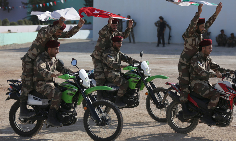 """Troops of the """"National Army"""" in a graduation ceremony in the al-Baba, rural Aleppo – August 2018 (Reuters)"""