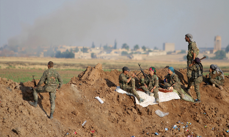 """Troops of the (Kurdish) """"People's Protection Units"""" in Tell Abyad, rural Raqqa (Reuters)"""