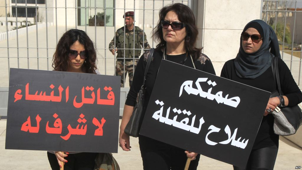 The signs say: Your silence is the murderers' weapon – Women's killer has no honor - Sit-in in Palestine against honor crimes (AFP)