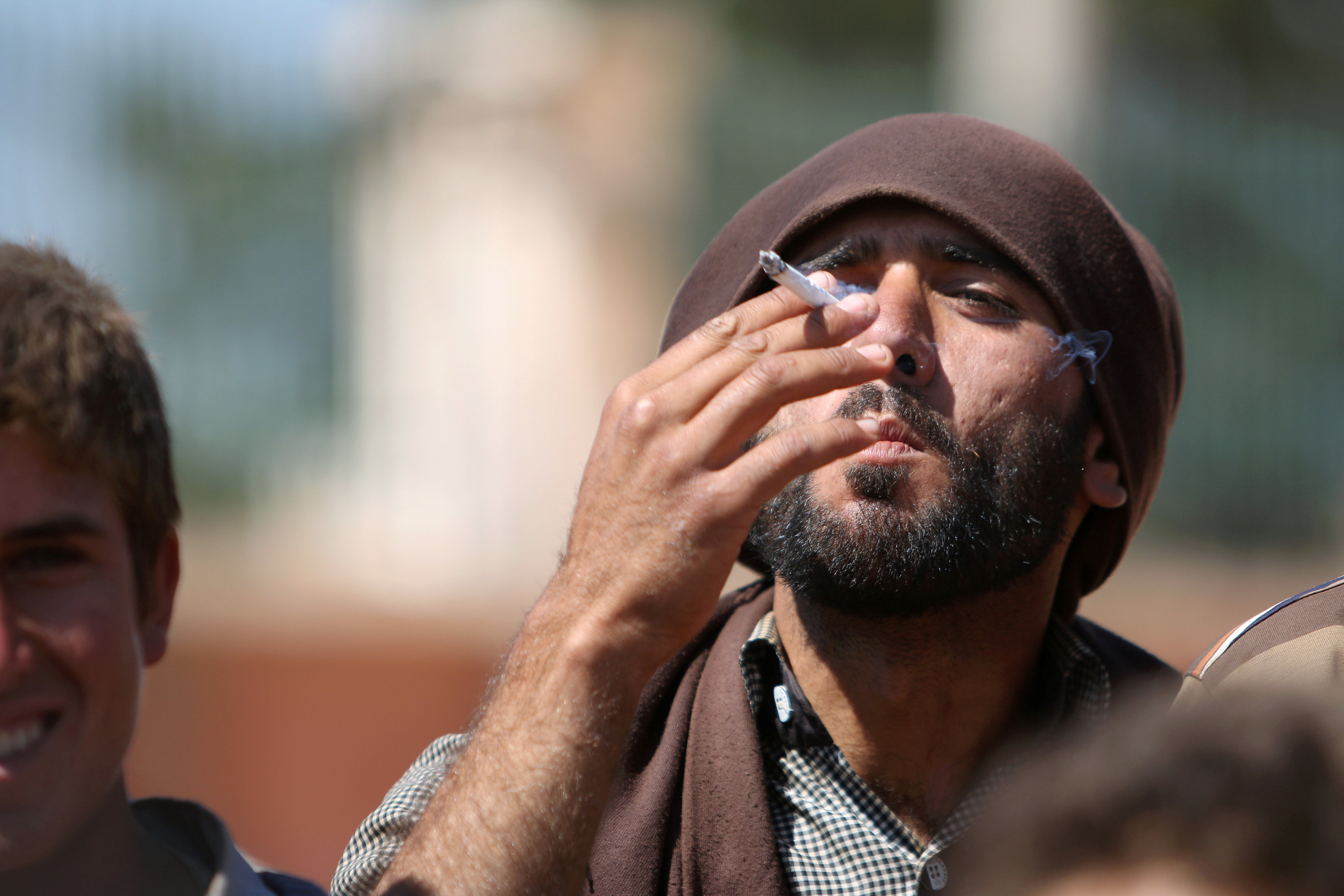 A man fleeing the city of Manbaj smoking a cigarette after reaching SDF-held areas - 2016 (Reuters)