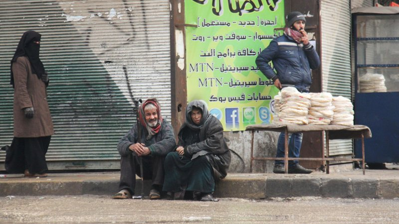 30 December 2017 - Citizens sitting on the sidewalk in front of a telephone service shop in Idlib (rte)