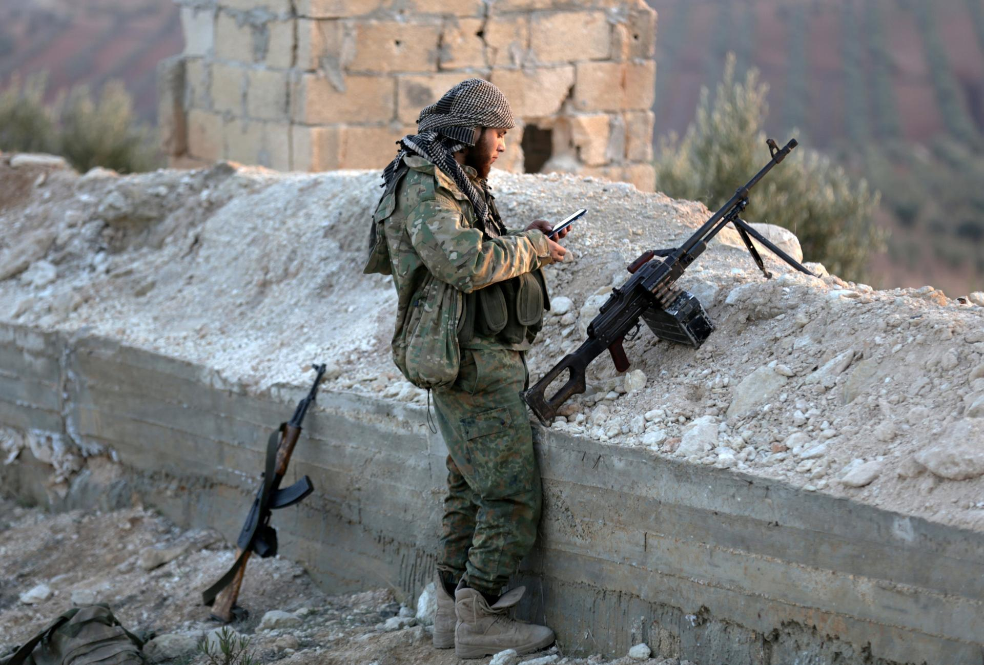 An opposition combatant in Afrin District talking with the mobile phone - Feb. 6, 2018 (Reuters)