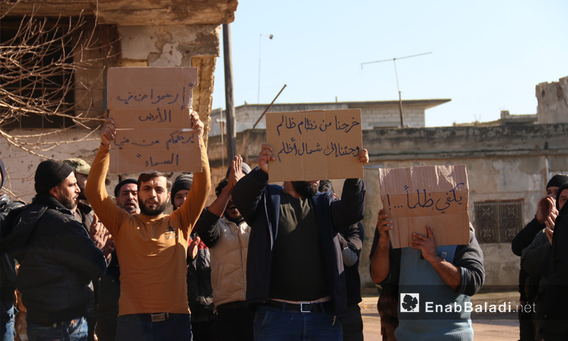 A demonstration in the town of al-Fu'ah in refusal of the rents imposed on houses -December 24, 2018 (Enab Baladi)