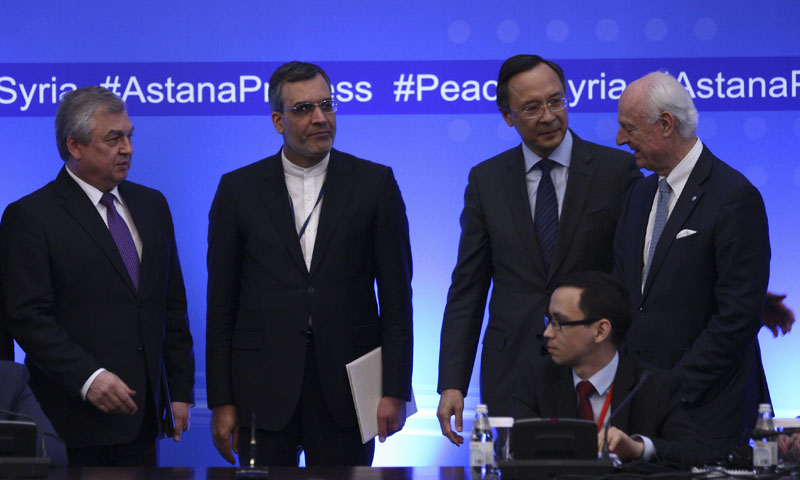 """The delegates of the guarantor states, Russia, Turkey and Iran, during the """"Astana"""" talks – May 2017 (Reuters)"""