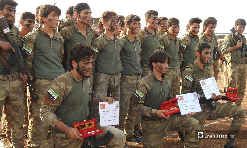 """The graduation of a new batch of the """"Syrian National Army,"""" northern rural Aleppo – October 14, 2018 (Enab Baladi)"""