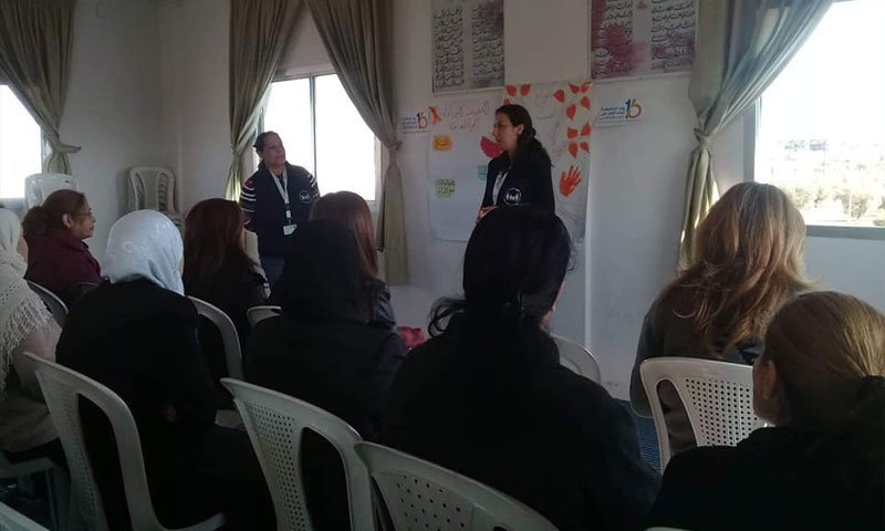 """A photo from the activities of the campaign of """"16 Days of Combatting Violence against Women"""" in Swaida - 10 December 2018 (Official Facebook page of the Syrian Family Planning Association - SFPA)"""